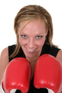 Business woman in boxing gloves.